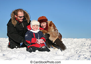 winter family sit on snow