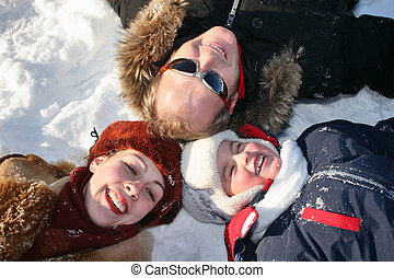 winter family lies on snow
