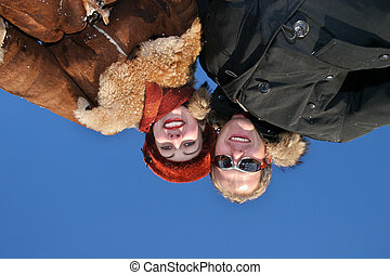 winter couple on sky
