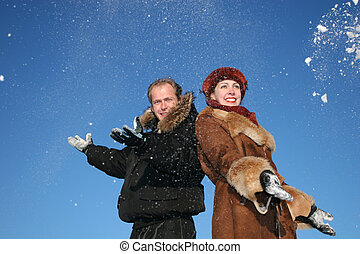 winter couple throw snow