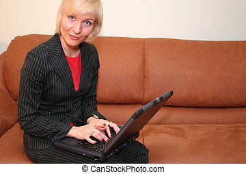 business woman with notebook on sofa