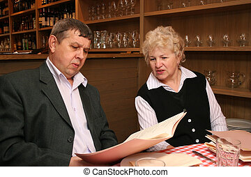 old couple in cafe with big prices