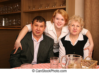 senior couple with daughter