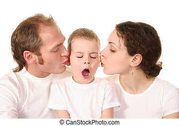 yawn boy with kissing parents