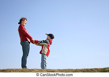 mother with child on spring meadow