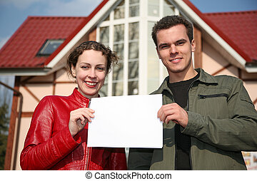 couple with card and house