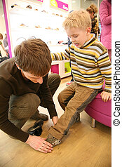 father with son in shop