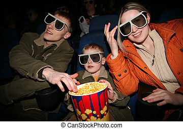 family in stereo cinema focus on popcorn