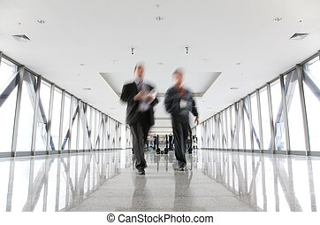 moving businessmen and escalator