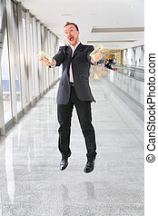 jumping businessman with money