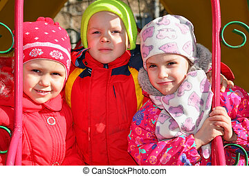 boy with girls in kindergarten