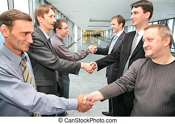 shaking hands business partners