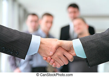 shaking hands with wrists and business team