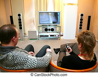 couple with home theater