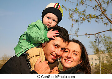 family with baby on shoulders 3