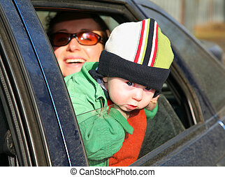 mother with baby in car