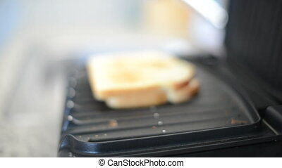 Dolly move in of sandwich on electric grill