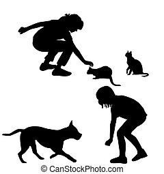 Children silhouettes playing with pets