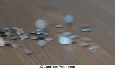 Throwing coins on a table