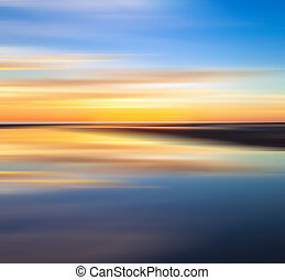 Reflection of colorful sunset with long exposure effect