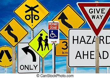 Road Signs - Multiple road signs against a blue cloudy sky....