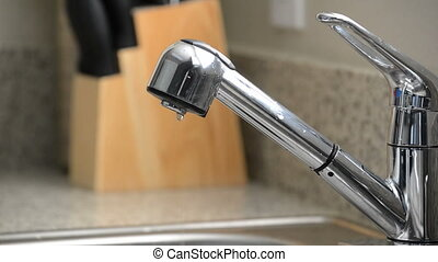 Close up of dripping kitchen faucet