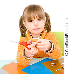 girl with paper and scissors