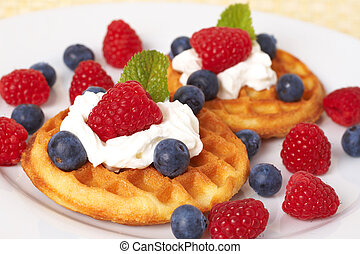 Belgian waffles with berries and cream - Belgian waffles...