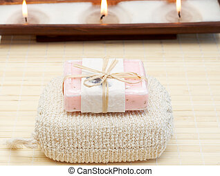 Relaxing spa scene with body products - exfoliating sponge...