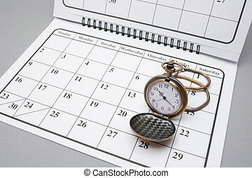 Pocket Watch on Calendar with Grey Background
