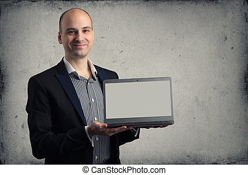 handsome man smiling showing laptop