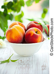 peaches - Bowl of fresh peaches on the table