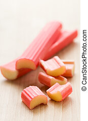 rhubarb - fresh rhubarb sticks and pieces on the wooden...