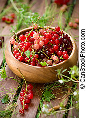 currant - berries of a currant in a wooden bowl