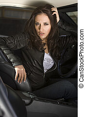 business woman in the car - European businesswoman siting in...
