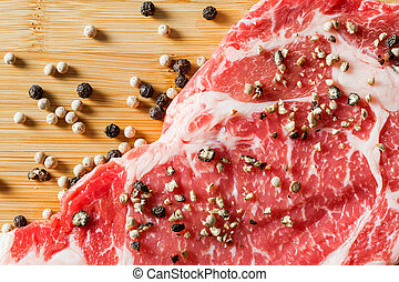 close up aged beef ribeye with pepper - Close up aged beef...