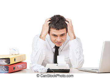 young man sitting at work and worrying businessman working...