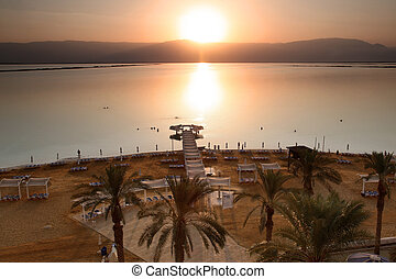 Sundown at The Dead Sea. The Dead Sea is second saltiest body of water in the world, with a salt content of 33% that creates a natural buoyancy.