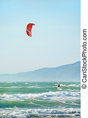 Kite Surfing in San Francisco - Surfer with red kite surfing...
