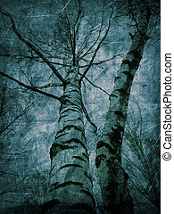 Textured bare trees - Blue vintage background with bare...