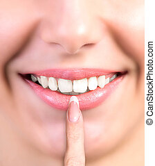 White Smile Teeth - Face Woman is Smiling while being at the...