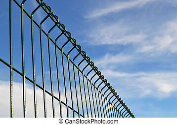 Fence details with blue sky