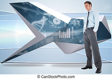 Happy businessman standing with hands in pockets against...