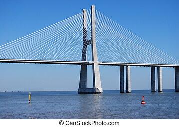 Vasco da Gama Bridge over River Tagus in Lisbon - Vasco da...