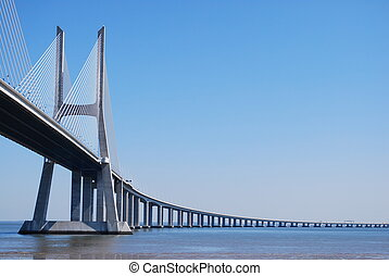 Vasco da Gama Bridge over River Tagus in Lisbon - Vasco da...
