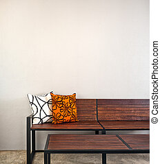 Garden bench as interior furniture with two pillow