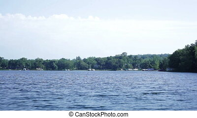 Boat cruising - Boat moving across a large lake Scenic view...