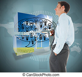 Happy businessman standing with hand in pocket against holographic earth with pictures