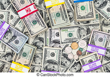 Bundles of different denomination dollar bills - Financial...