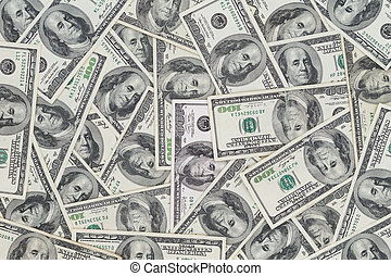 Hundreds of new Benjamin Franklin 100 dollar bills arranged...